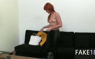 redhead princess teasing on dark couch