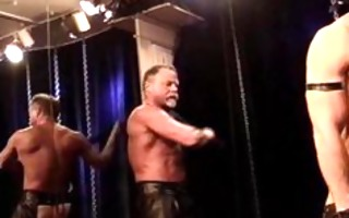 masked muscle guy in bondage gets a flogging and