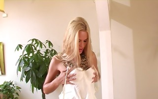 seductive golden-haired disrobes and teases