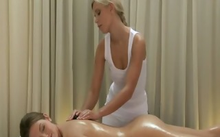 brunette honey getting massaged by a sexy blonde