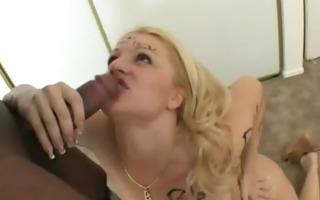 a cheating wife copulates a dark fellow while