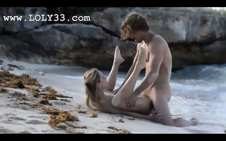 fluent art sex of sexually excited couple on beach