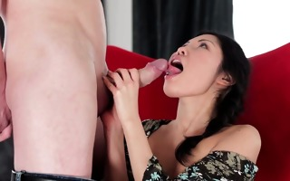 oriental beauty gives a blow job to visitor