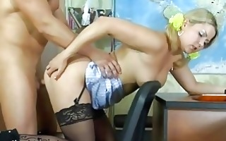 nice-looking blonde secretary in stockings