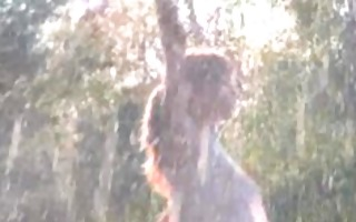 american babe stripping in the garden